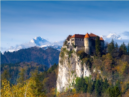 Bled, the Castle, with Triglav in the background (Author-Klemen Kunaver)