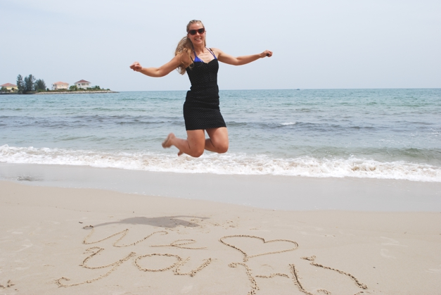 Sophie Roberts from the UK jumps for joy in Singapore during the Big Blog Exchange