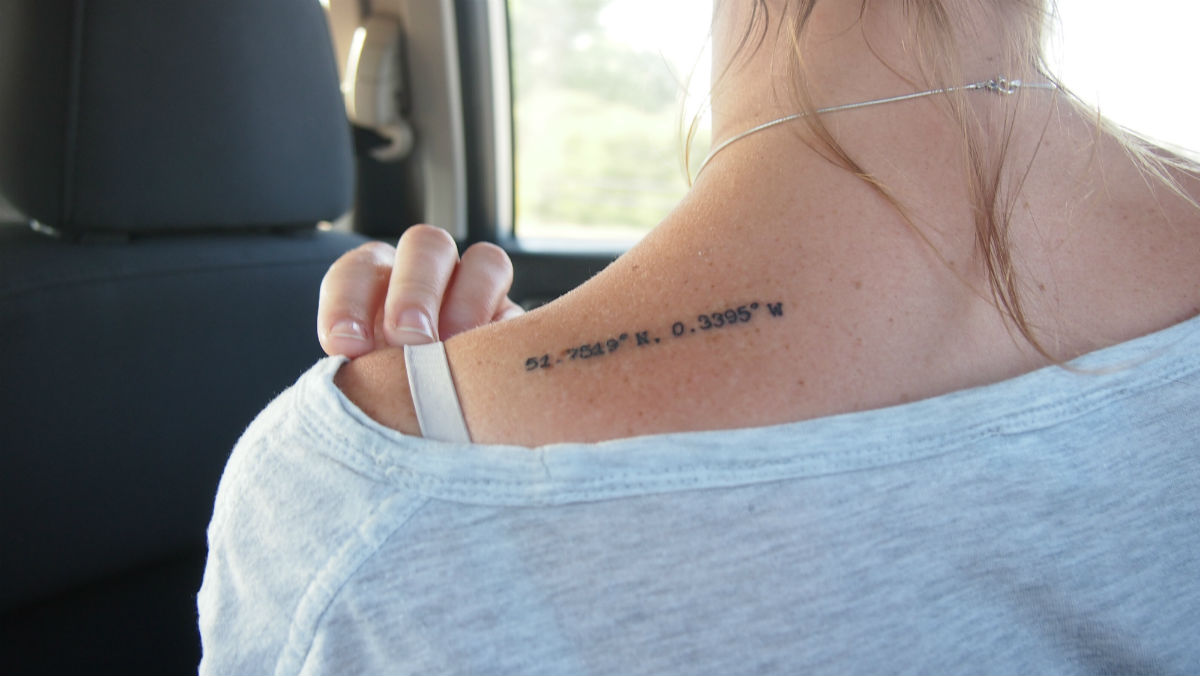 Sarah had the longitude and latitude of her home town tattoed on her shoulder