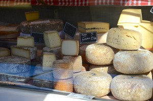 French market stall selling cheese
