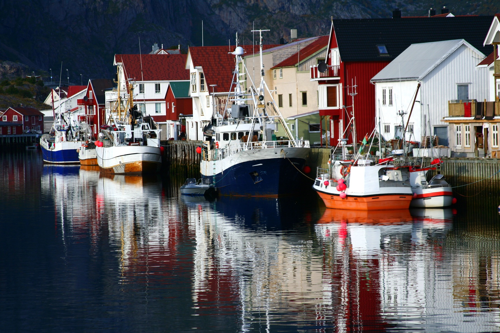 Boats reflecting in the sea Norway