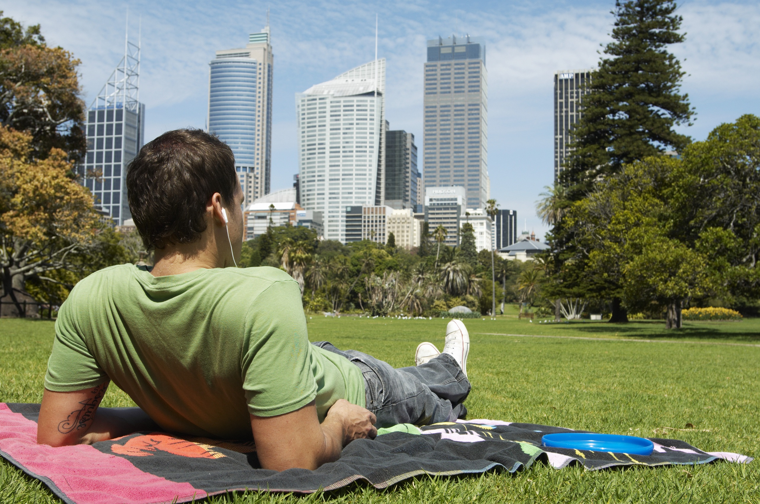 Man sitting in park in Sydney