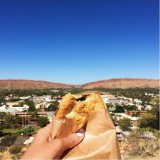 A delicious Aussie meat pie at the Anzac Hill Lookout in Alice Springs, NT. Alice Springs is smack dab in the middle of Australia.