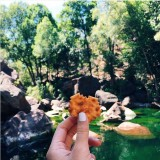 Munching on some Arnott's Shapes (another classic Aussie snack) after a swim at Motorcar Falls, Kakadu National Park