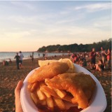 The Aussie way to have fish 'n' chips, by the beach in the sunset, in Darwin on a Sunday, with the  Mindil Sunset Market on.