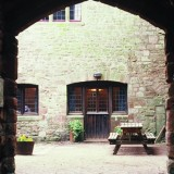 img41369-Exterior-courtyard-of-the-YHA-St-Briavels-hostel-in-England