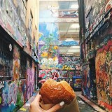 Enjoying a morning croissant choc chips with a side of urban art at Rutledge lane in Melbourne.