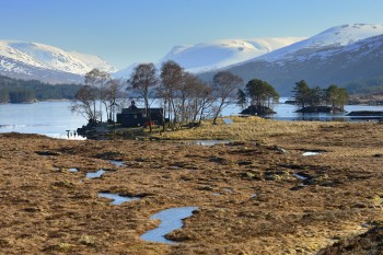 Loch Ossian with Ben Alder in the distance.  This Munro is composed of sediment deposited on the floor of a long-gone sea. ©Lorne Gill/SNH.