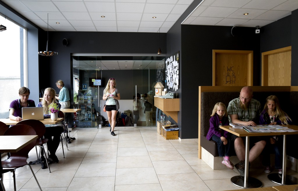 Guests at Reykavik Downtown hostel, Iceland, enjoying the lounge and coffee house area.