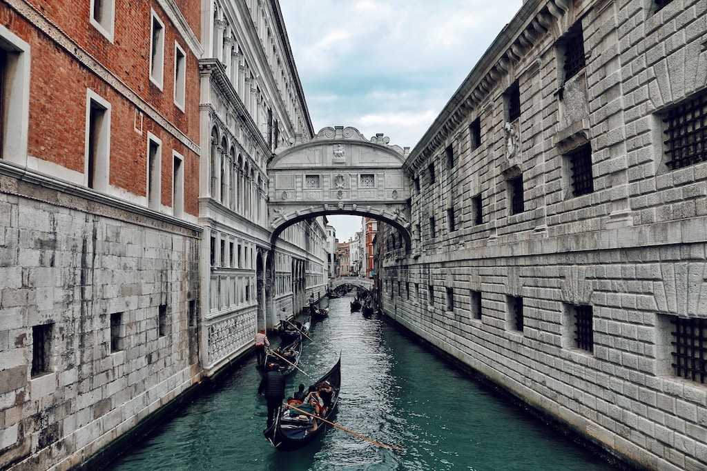 Gondolas glide under the Bridge of Sighs